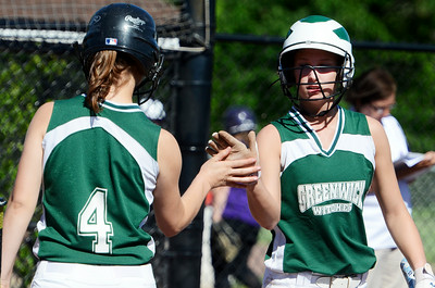Greenwich's Carolin Strasswimmer high-fived teammate Mariah Linnett after running to home plate during their softball regional game against Ticonderoga. Photo Erica Miller 6/3/13 spt_Softball1_Tues