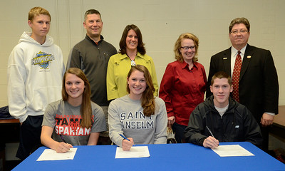 Student athletes, from left; Grace and Meredith Hungerford and Matt Flynn sign letters of intent to attend University of Tampa, and Saint Anselm College dring a signing ceremony Thursday at Saratoga Springs High School. Family behind from left are Grace and Meredith's brother Elliott and parents Dave and Shannon Hungerford along with Matt's parents Kathy and Jim Flynn. Ed Burke 6/13/13