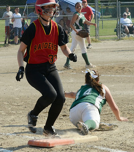 Mechanicville's Kim Thompson is safe at first beating the throw to Greenwich's Kali Nolan during Friday's Section II Class C final at Clifton Commons. Ed Burke 5/31/13