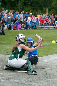 Greenwich's catcher Mariah Linnett narrowly misses the tag against a Sandy Creek rival Saturday morning during the Section III Class C State Semifinal softball game. Photo Eric Jenks 6/8/13