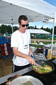 Bryan Leggett sautee's vegetables Friday afternoon. for hungry supporters of the 2011 Babe Ruth World Series games held in Clifton Park. Photo By Eric Jenks 8/27/11