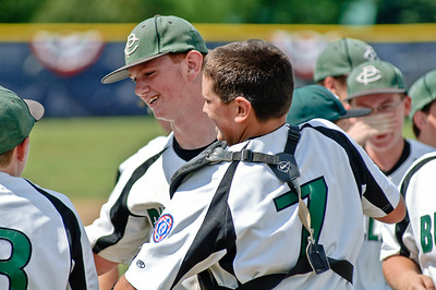 Members of the Clifton Park Bulldogs (Max Alverson and Mike Gilloley center) celebrate after winning the 2011 Babe Ruth World Series game against Guilderland Friday Morning. Photo By Eric Jenks 8/27/11