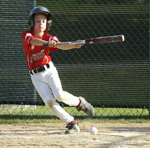 Wilton's Sam Cirenza bunts his way to second base during Wednesday's game against Clifton Park White. Ed Burke 7/27/11