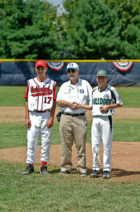 Guilderland Pitcher Alex Varsanyi and Clifton Park Pitcher Mason Munger are recognized as the MVP's of the 2011 Babe Ruth World Series Game held friday morning in Clifton Park by Babe Ruth Hall of Famer Bill Pullan. Photo By Eric Jenks 8/27/11