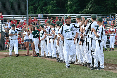 The Clifton Park Bulldog Coaches high five their team before the start of the 2011 Babe Ruth World Series Game Friday Morning agaist Guilderland. Photo By Eric Jenks 8/27/11