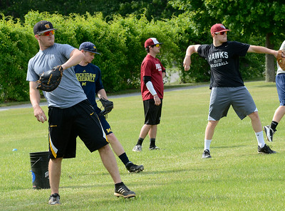 Saratoga Brigade team members loosen up during the team's first practice Wednesday at Veterans Memorial Park. Ed Burke 6/5/13
