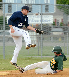 Sanford Mainers' Cole Martin gets in under the throw to Saratoga Brigade third baseman Matt Beaty during Saturday's game at East Side Rec. Ed Burke 6/29/13