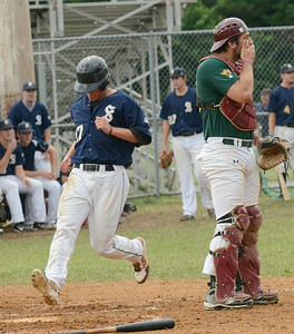 Saratoga Brigade's  Gage Green scores after a hit by teammate Matt Beaty during Saturday's game at East Side Rec. Sanford catcher Nate LaPoint at right. Ed Burke 6/29/13