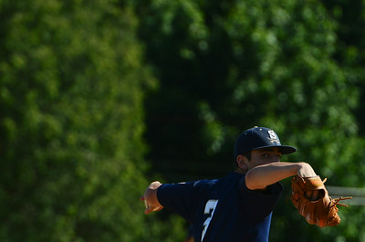 Saratoga Brigade's pitcher Andy Cox warms up during their baseball game against Danbury Westerners at East Side Rec on Thursday afternoon. Photo Erica Miller 6/20/13 spt_Brigade2_Fri