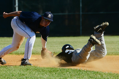 Saratoga Brigade's Craig McConaughy misses the tag of Danbury Westerners Jonathan Testani as he slides safely into second base, at East Side Rec on Thursday afternoon. Photo Erica Miller 6/20/13 spt_Brigade3_Fri