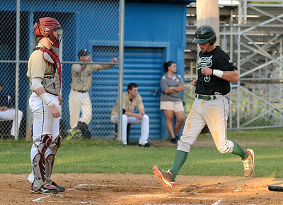 Playing for the Vermont Mountaineers, Burnt Hills graduate Bret Dennis scores on a hit by teammate Mike Triller as Saratoga Brigade catcher Brian O'Keefe looks on during Friday's game at East Side Rec. Ed Burke 6/14/13