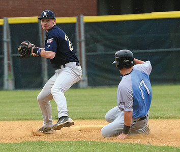Saratoga Brigade's Dylan Delaney looks for the double play after getting the out on Mystic Schooner Tyler Boyd during the Brigade's inaugural game at East Side Rec Thursday. Ed Burke 6/6/13