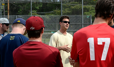 Saratoga Brigade coach Garrett Baron talks to his team Wednesday during their first day of practice at Veterans Memorial Park. Ed Burke 6/5/13
