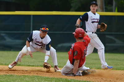Granville's Justin Capuano slides out to second base to Saratoga Stampede's Jordan Prehoda during their game at East Side Rec. Photo Erica Miller 6/27/13 spt_Stampede3_Fri