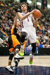 Watervliet Cannoneer Jordan Gleason flies past Schuylerville Black Horse Tyler Hayes Saturday evening during their game at the Glens Falls Civic Center. Photo Eric Jenks 3/2/13