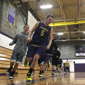 Cameron Coons leads the Saints around the boards during Wednesday's warm up before varsity basketball practice a Saratoga Central Catholic. Ed Burke 11/28/12