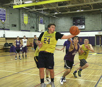 Keegan Murphy grabs a rebound during varsity basketball practice Wednesday at Saratoga Central Catholic. Ed Burke 11/28/12