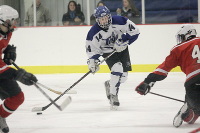 Saratoga's Drew Patterson takes a slapshot during Wednesday's win over Guilderland/Mohonasen. Ed Burke 11/28/12