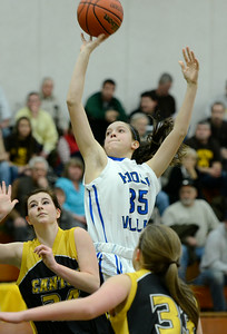 Hoosic Valley's Alyssa Paul shoots over Canton defenders Kali Frank, left, and Emily Pinckney during Tuesday's Class C Regional semi-final at SUNY Adirondack. Ed Burke 3/5/13