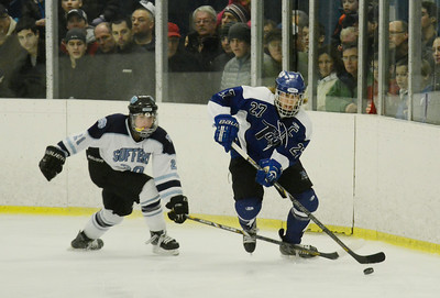 Saratoga's Devin Smith is pursued by Suffren's Nick Jaeger during state quarter-finals in Monsey. Ed Burke 3/2/13