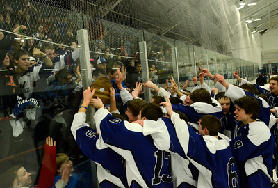 Saratoga Blue Streaks celebrate their state quarter-final win over Suffern Saturday night in Monsey. Ed Burke 3/2/13