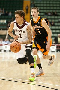 Watervliet Cannoneer Jordan Gleason moves up court past Schuylerville Black Horse Shane Lyon Saturday evening during their game at the Glens Falls Civic Center. Photo Eric Jenks 3/2/13