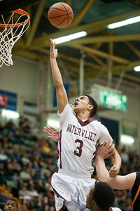 Watervliet Cannoneer Ty'Jon gilmore goes up for a basket Saturday evening during their game against the Schuylerville Black Horses at the Glens Falls Civic Center. Photo Eric Jenks 3/2/13