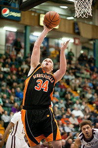 Schuylerville Black Horse Dan Waldron goes for a shot on the basket during the game against the Watervliet Cannoneers Saturday evening at the Glens Falls Civic Center. Photo Eric Jenks 3/2/13