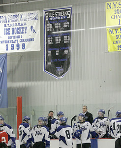 A banner recognizing the accomplishments of the varsity Blue Streaks hockey team hangs over the Saratoga bench after being raised before Wednesday's game against Guilderland/Mohonasen at Saratoga Springs Ice Rink. Ed Burke 11/28/12