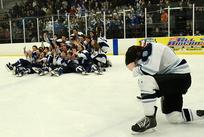 Suffering Suffern player Kevin Hill mourns their loss as the Saratoga Blue Streaks celebrate their victory Saturday night in Monsey. Ed Burke 3/2/13