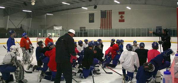 Coaches Dave Torres, left, and Tim Grande talk with their team during the Saratoga Springs High School hockey practice on Tuesday at Saratoga Springs Ice Rink. Jennifer Collet photo 11/27/12