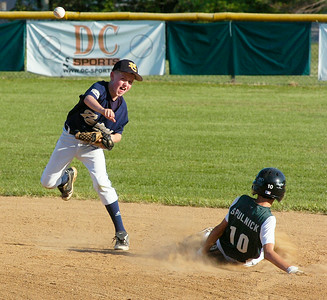 North Colonie Padre Ben Pesuel fires to first but misses the double play after getting the out on Clifton Park's Mike Spulnick. CP's Mike Jeffers was safe at first on the base hit. Ed Burke 7/27/10