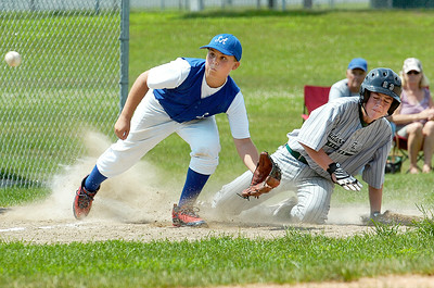 Saratoga Americans Liam Gibney waits for a pass as Hudson Fall's Dalton Hogan slides safely into third base during their District 11 Little League Championship Saturday afternoon at West Side Rec. Photo Erica Miller 7/17/10 spt_SarAmHuds1_Sun