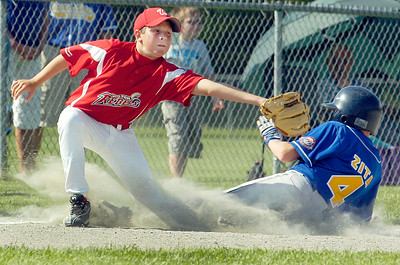 Queensbury Matt Zita slides safely into third base with Nick McDonough, Wilton Rebels, during their little league baseball Cal Ripken game at Gavin Park Monday afternoon. Photo Erica Miller 7/19/10 spt_WiltQueens2_Tues