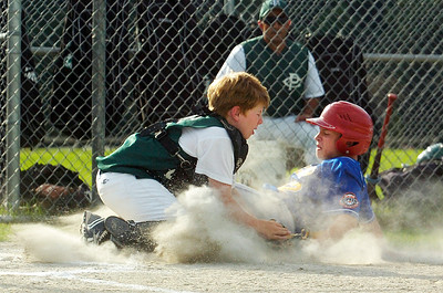 Queensbury's Erik Wetersten slides safely into home plate into catcher for Clifton Park Frank Pizzo during their Cal Ripken Little League Championship game at Gavin Park Monday evening. Photo Erica Miller 7/20/10 spt_QueensCP1_Wed