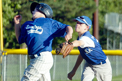 Saratoga American's Jake Fauler tags out Saratoga National Dylan Capone on his way to third base during their 11-U little league Championship at East Side Rec Monday evening. Photo Erica Miller 7/26/10 spt_AmNat'l5_Tues