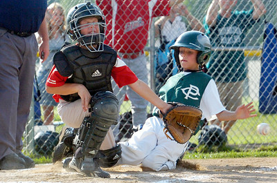 Clifton Park's Jack Normandin slides safely into homeplate as Wilton Rebels catcher Matt Meyers waits for a pass during their little league baseball Cal Ripken Championship game at Gavin Park Monday afternoon. Photo Erica Miller 7/19/10 spt_WiltonCP2_Tues