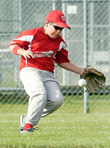 Wilton Rebel 9-U runs to catch a ground ball hit towards him during their little league baseball Cal Ripken Championship game against Clifton Park at Gavin Park Monday afternoon. Photo Erica Miller 7/19/10 spt_WiltonCP1_Tues