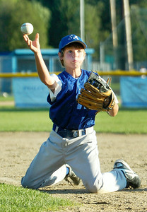 Saratoga American's Will Messier catches a ground ball passing it to first base during their game against Saratoga National's 11-U little league Championship at East Side Rec Monday evening. Photo Erica Miller 7/26/10 spt_AmNat'l4_Tues