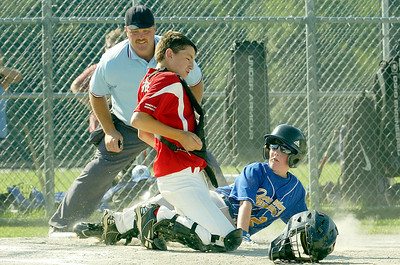 Queensbury Clay Robertson slides into home plate with catcher for Wilton Rebels Danny Hobbs during their little league baseball Cal Ripken game at Gavin Park Monday afternoon. Photo Erica Miller 7/19/10 spt_WiltQueens3_Tues