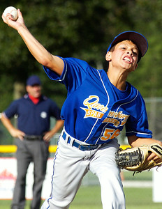 Queensbury pitcher Brett Rodriguez warms up during their Cal Ripken Little League Championship game against Clifton Park at Gavin Park Monday evening. Photo Erica Miller 7/20/10 spt_QueensCP5_Wed