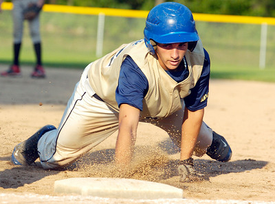 Adirondack Hawks Thomas Diemer slides safely back to first base during their 15U game against Brunswick Buckeyes at Gavin  Park Wednesday evening. Photo Erica Miller 7/21/10 spt_AdkBruns4_Thurs