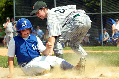 Saratoga Americans Liam Gibney slides safely into third base as Hudson Falls' Dalton Hogan tries to tag him out during their District 11 Little League Championship Saturday afternoon at West Side Rec. Photo Erica Miller 7/17/10 spt_SarAmHuds3_Sun