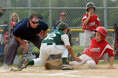 Wilton Rebels Jake Hart slides into home plates as pitcher Joseph Novenche, Clifton Park, is tagged out during their little league baseball Cal Ripken Championship game at Gavin Park Monday afternoon. Photo Erica Miller 7/19/10 spt_WiltonCP4_Tues