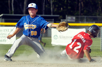 Wilton Rebel Jack Herman slides safely into second base as Brett Rodriguez waits for a pass during their little league baseball Cal Ripken game at Gavin Park Monday afternoon. Photo Erica Miller 7/19/10 spt_WiltQueens5_Tues