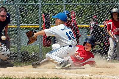 Wilton Rebel Justin Smith slides into home plate as Beekman's pitcher Anthony Heinrich waits for a pass during their Cal Ripken Little League baseball game at Gavin Park Saturday morning. Photo Erica Miller 7/17/10 spt_WiltBeek5_Sun
