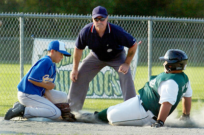 Clifton Parks Michael Napolitano slides into third base as Queensbury's third baseman Aaron Cook tags him out on base during their Cal Ripken Little League Championship game at Gavin Park Monday evening. Photo Erica Miller 7/20/10 spt_QueensCP4_Wed