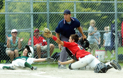 Clifton Park Sargeat slides into home plate as catcher Danny Hobbs, Wilton Rebels, tags him out during their 12-U game at Gavin Park Sunday afternoon. Photo Erica Miller 7/18/10 spt_WiltonCP2_Mon