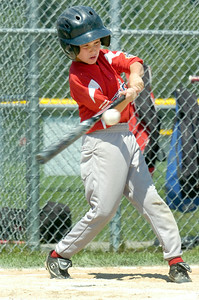 Wilton Rebel Justin Smith up to bat during their Cal Ripken Little League baseball game at Gavin Park against Beekman Saturday morning. Photo Erica Miller 7/17/10 spt_WiltBeek1_Sun