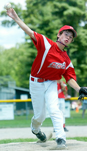 Wilton Rebels pitcher Jack Herman warms up during their 12-U game against Clifton Park at Gavin Park Sunday afternoon. Photo Erica Miller 7/18/10 spt_WiltonCP1_Mon